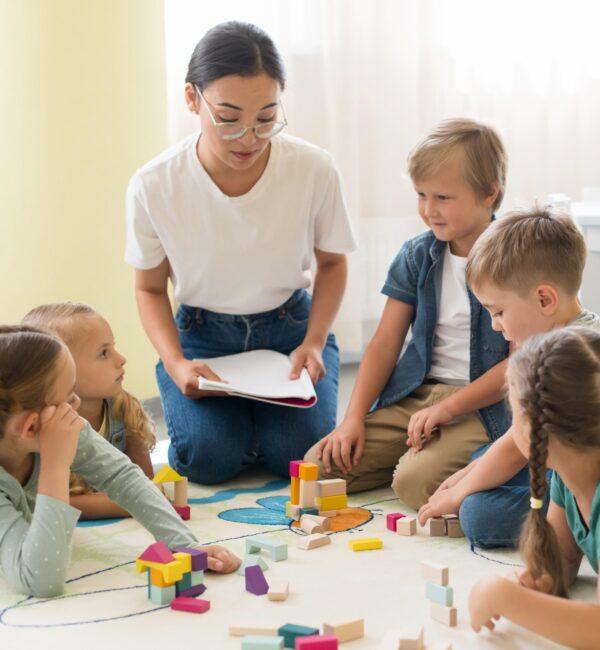 front-view-woman-teaching-kids-kindergarten
